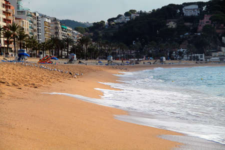 beach in the morning. view of the sea and the beach and town. Beautiful sea landscape with blue sky and sun. summer day. Mediterranean Sea. spain