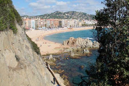 A beautiful view of the city beach with rocks in Lloret de Mar, Costa Brava, Catalonia, Spain. Mediterranean Sea. Summer resort Banque d'images