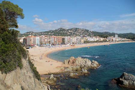 A beautiful view of the city beach with rocks in Lloret de Mar, Costa Brava, Catalonia, Spain. Mediterranean Sea. Summer resort Éditoriale