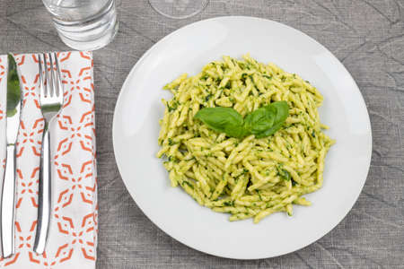 Pasta and pesto. Typical Italian dish of traditional Genoese cuisine (Liguria). Trofie with homemade pesto. Fresh pasta with pesto. Archivio Fotografico