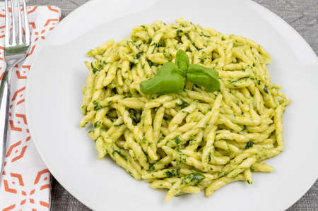 Pasta and pesto. Typical Italian dish of traditional Genoese cuisine (Liguria). Trofie with homemade pesto. Fresh pasta with pesto.