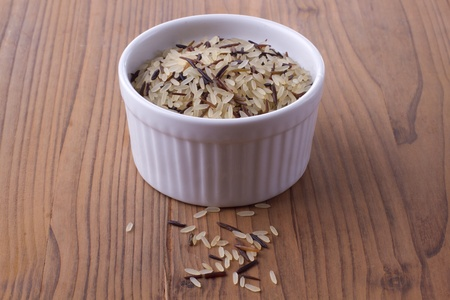 Wild rice in a bowl on a wooden background