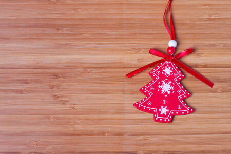 Christmas tree hanging over wooden background photo