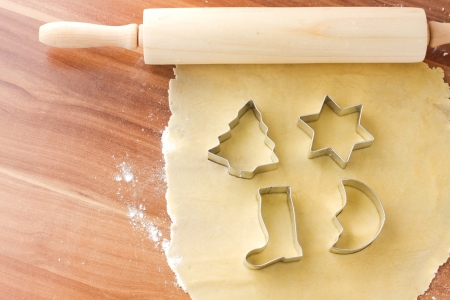Dough with cutting form preparation for baking christmas cookies photo