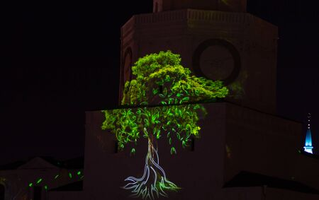 Green tree in light show on the wall of Kazan Kremlin in Russia Stock Photo - 130108640