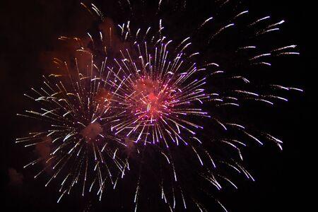 Bright lights of firework on black sky Stock fotó - 130109120