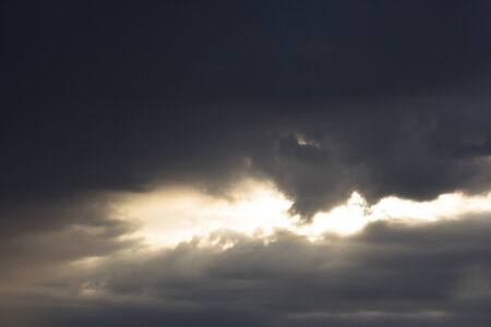 Dramatic sky with clouds and sunlight