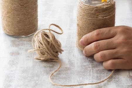 DIY wrapped bottles with twine Stock Photo