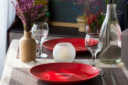 Served table with tableware for the romantic dinner for two person