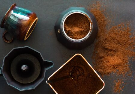 Ground coffee and geyser coffee maker on the black background Stock Photo