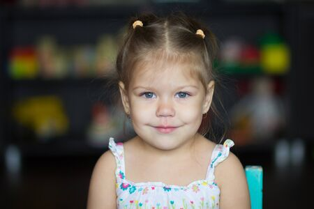 Portrait of cute little girl looking at camera