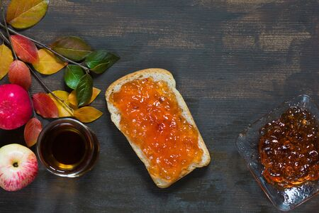 Top view of apple jam on the toast on the brown background Stock Photo