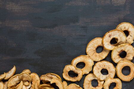 Flat lay with dried apple on the brown background