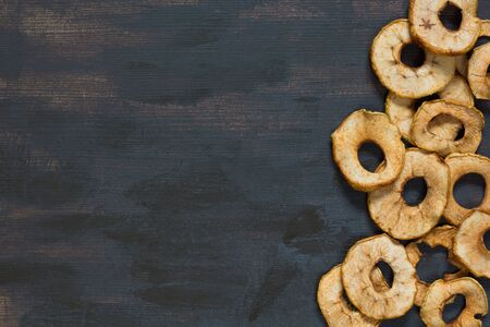 Flat lay with dry apple on brown background