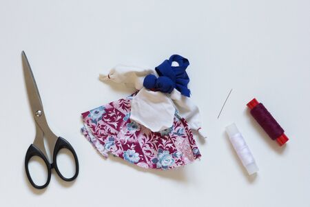 Top view of handmade doll from material on white background Stockfoto