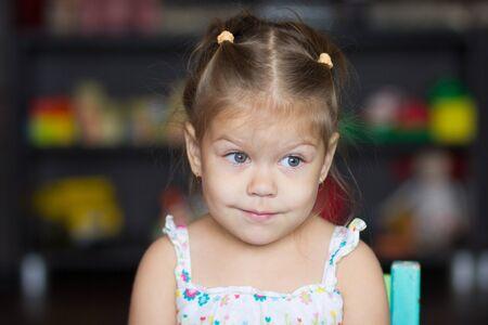 Portrait of cute little girl looking aside