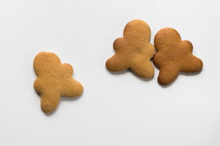 Baked gingerbread cookies men on the white background