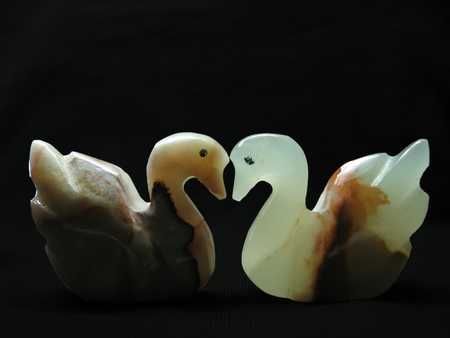 onyx: Two swans figurines made of onyx. Stock Photo