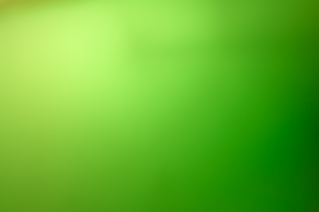 Abstract warm blurred green gradient background from white to green Imagens