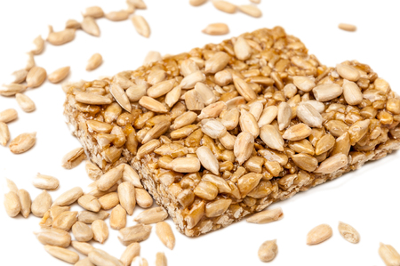 A side view of a two gozinaki bars with sunflower seeds isolated on a white background Stock Photo