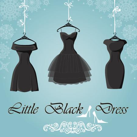 작은 검은 드레스. 겨울 눈송이 배경