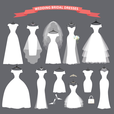 bridal: Set of bridal wedding dresses hang on ribbons