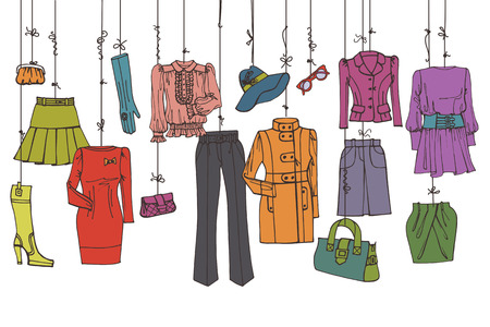 woman's clothing: Womans colored clothing and accessories hanging on ropes