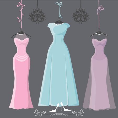 Three retro long bridesmaid dresses hang on ribbons