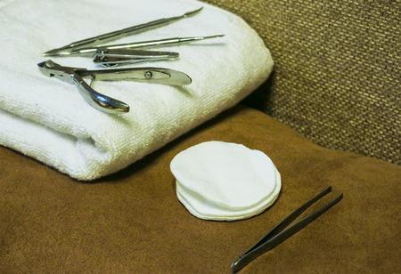 Manicure tools on a white towel. Scissors, nail file, sticks, etc.