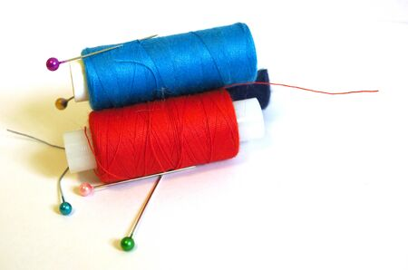 Colored thread coils on white background, sewing, place for text Banco de Imagens