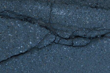 Old cracked asphalt surface. Background Reklamní fotografie