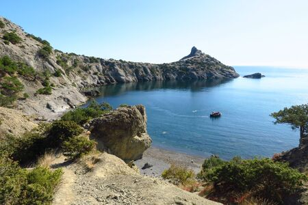 Superb bright sunny southern seascape overlooking the turquoise black sea and beautiful cliffs on the Golitsyn trail. The resort city New World , Crimea, Russia. Holydays