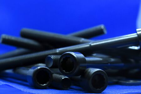 two screw bolts on the blue background, long bolts, technic, repair Stok Fotoğraf