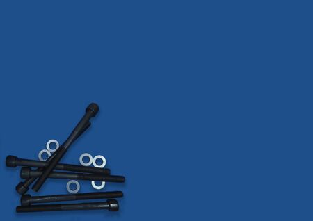 Much of screws for textured background. Toned. two screw bolts on the classic blue background, long bolts, technic, repair Stok Fotoğraf