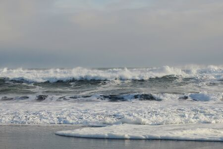 Grey ocean waves near the coast of Pacific ocean, Kamchatka peninsula