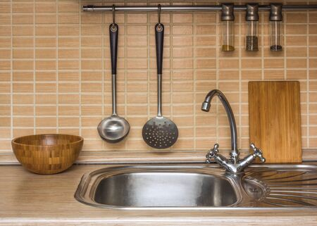 stove pipe: A part of an interior of home kitchen with utensils Stock Photo