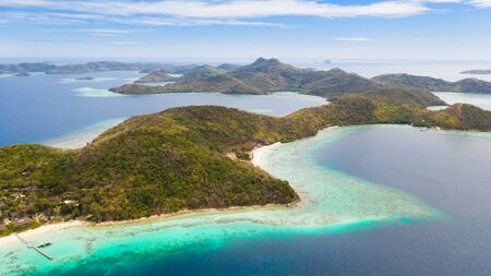 group tropical islands with white sand beach and blue clear water. aerial view seascape Philippines Palawan