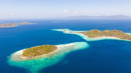 Islands of the Malayan archipelago with turquoise lagoons. Nature of the Philippines, top view. Philippines, Palawan
