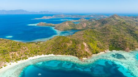 Blue sea and many islands.Ridge of islands in the ocean aerial view. Philippines, Palawan