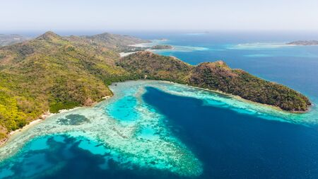 Seascape in the Philippines. Sea coast with mountains and islands aerial view. Philippines, Palawan