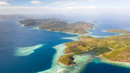 aerial seascape Lagoons with blue, azure water in middle of small islands. Palawan, Philippines. tropical islands with blue lagoons, coral reef. Islands of the Malayan archipelago with turquoise lagoons.