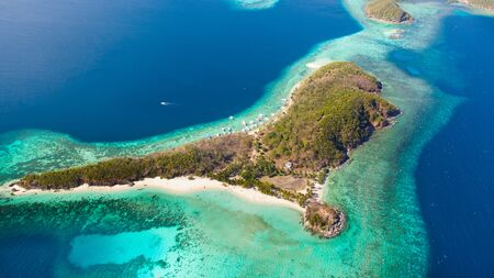 Islands and reefs of the Malay Archipelago.Beautiful island in the blue sea. Ditaytayan Island aerial view