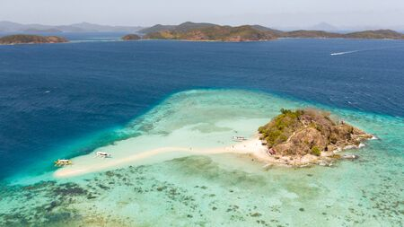 A small island for tourists with a sand bar.Tourists rest on a small island. Philippine Islands aerial view. Philippines, Palawan Reklamní fotografie - 131327583