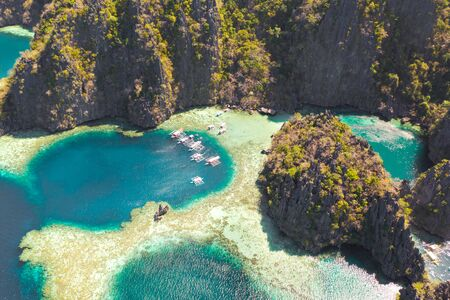 Twin Lagoon in Coron, Palawan, Philippines. Mountain and Sea. Lonely Boat aerial view
