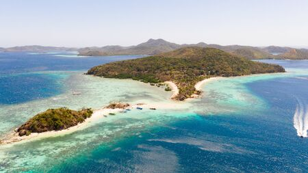 Tropical islands with white beaches. Turquoise lagoon and coral reefs, top view. Philippines, Palawan