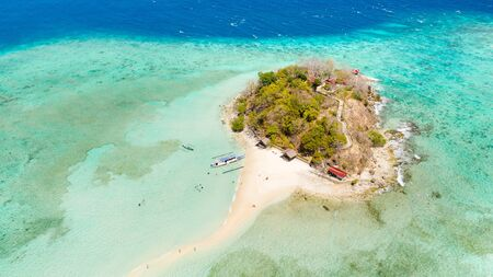 Small tropical island with white beach, top view.The island with white sand and coral reefs aerial view. Philippines, Palawan Reklamní fotografie
