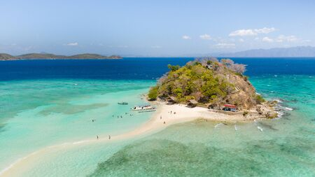 A small island for tourists with a sand bar.Tourists rest on a small island. Philippine Islands aerial view. Philippines, Palawan Reklamní fotografie