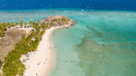 aerial view tropical island with sand white beach, palm trees. Malcapuya, Philippines, Palawan. Tropical landscape with blue lagoon, coral reef Reklamní fotografie