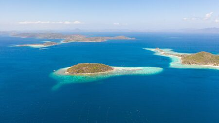 aerial seascape Lagoons with blue, azure water in middle of small islands. Palawan, Philippines. tropical islands with blue lagoons, coral reef. Islands of the Malayan archipelago with turquoise lagoons. Reklamní fotografie - 131330522