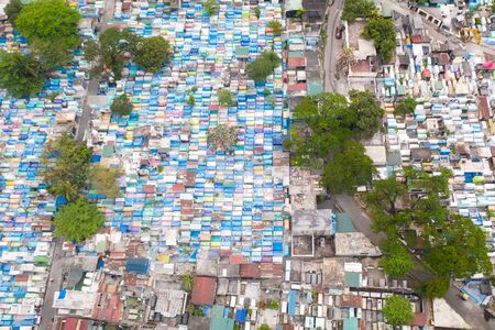 City cemetery in Manila, view from above. Many stone coffins and crypts. Old cemetery with residential buildings. Stock fotó